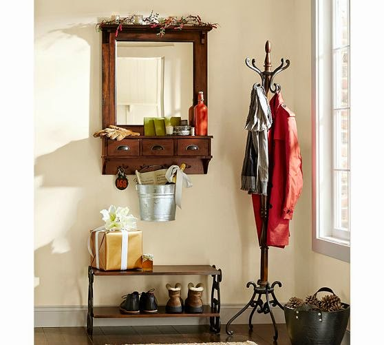 small entryway with mirror
