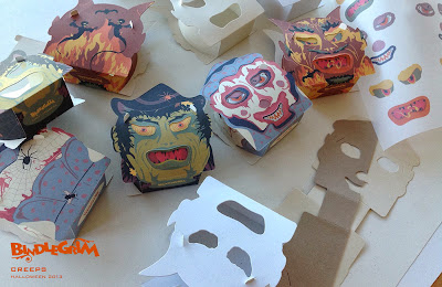 In the studio of Halloween artist Bindlegrim these vintage style slot-and-tab paper candy container lanterns begin to take shape