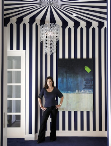 hallway with blue and white wall stripes