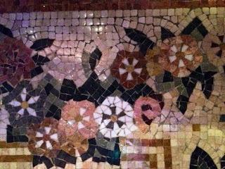 Glistening mosaic stones form floral focal points throughout the Bellagio's lobby  and conservatory areas/