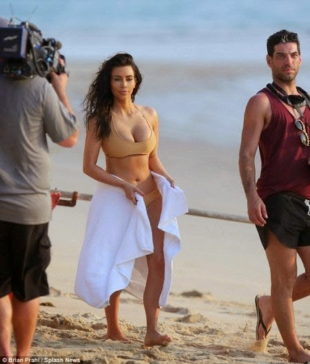 Kim Kardashian Flaunts Her Butt in Tiny Bikini for Beach Shoot