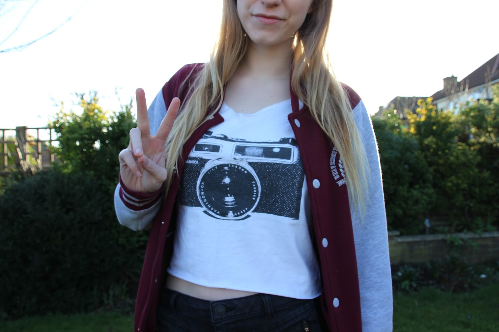 camera top baseball jacket outfit OOTD