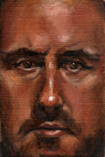 Oil painting of the face of a middle-aged man with light moustache and beard.