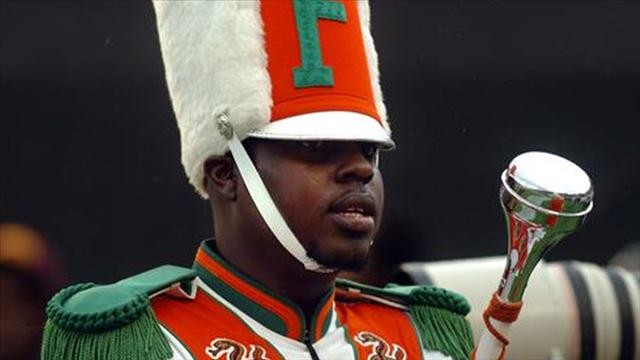 Thirteen people charged in hazing death of a gay drum major
