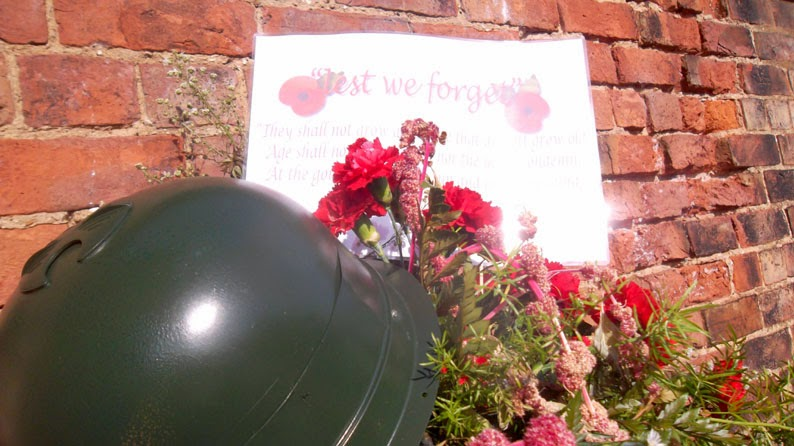 LEST WE FORGET: A floral tribute remembering the WW1 contribution made by member of the Forces from Brigg. This is the old water pump on Grammar School Road, South.
