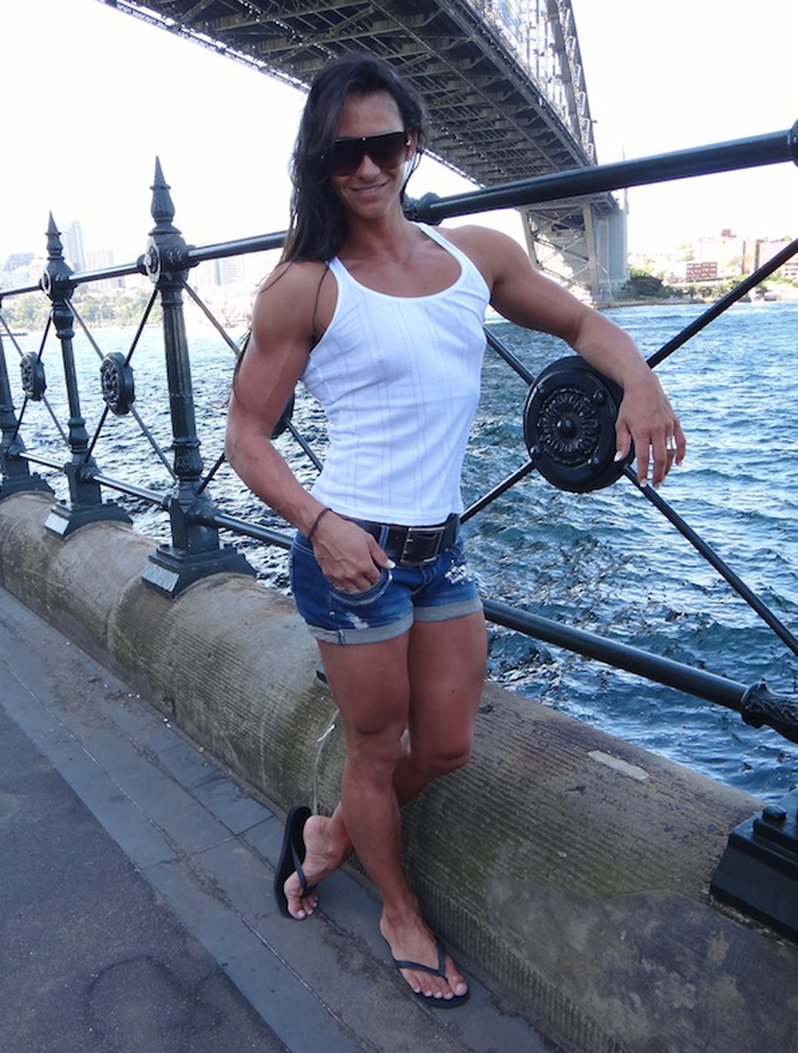 Cindy Landolt Models Her Muscular Arms And Legs By The Water