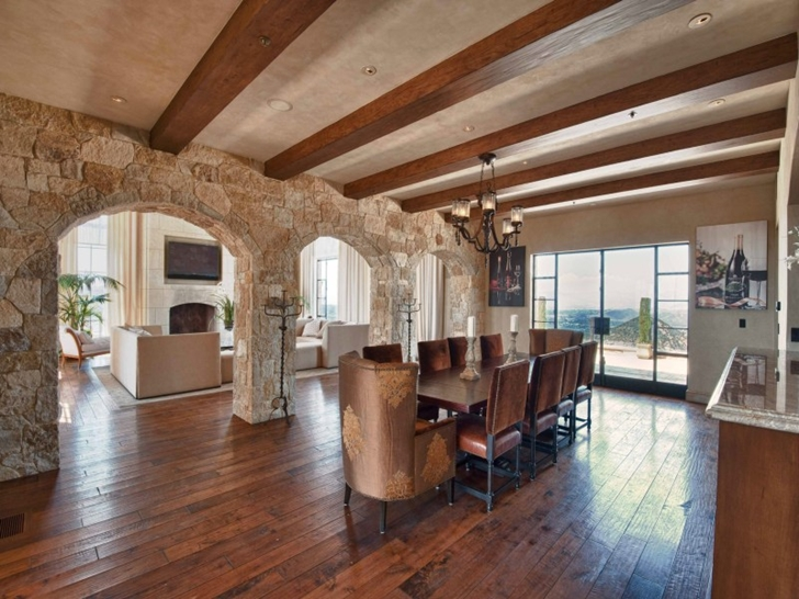 Large dining room in Mediterranean style vineyards home in Malibu