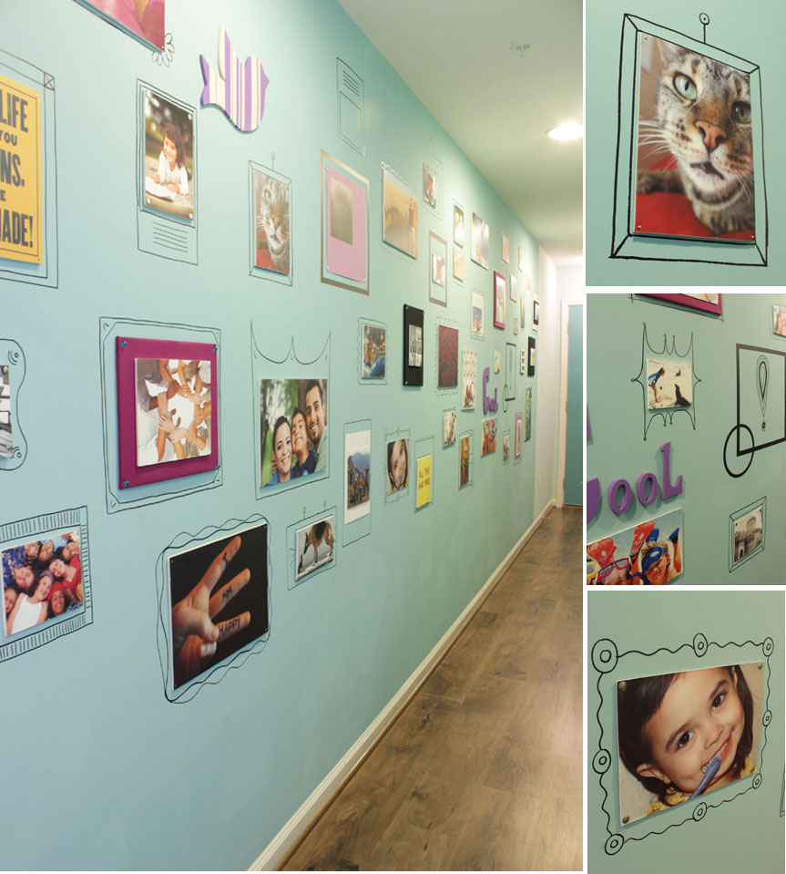 inexpensive pictures with drawn in the wall frames creating a gallery wall
