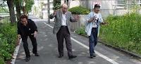 The men inside the rubber suit; Three generations of Godzilla costume actors: Tsutomu Kitagawa, Haruo Nakajima, Kenpachiro Satsuma in Bringing Godzilla Down to Size