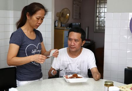 TNP caught up with Mr Tan and his wife, Madam Choong Siet Mei, 47, in their three-room flat in Woodlands yesterday (28 November 2015).