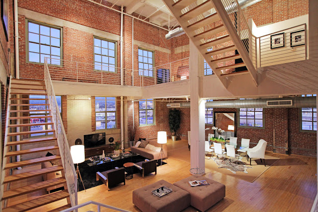 Photo of penthouse interiors along with staircases to upper floors