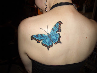 Blue Butterfly Tattoo on Girls Shoulder
