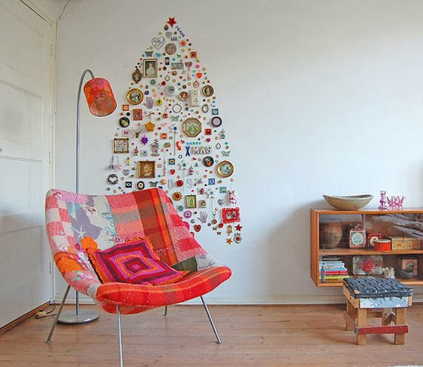 alternative christmas tree with trinkets against wall