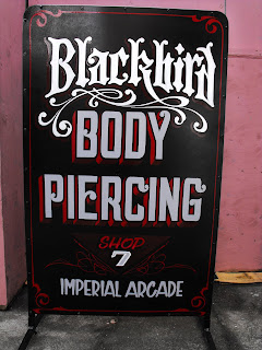 Blackbird Body Piercing hand painted vintage style signage