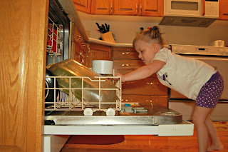 toddler helping chores dishes