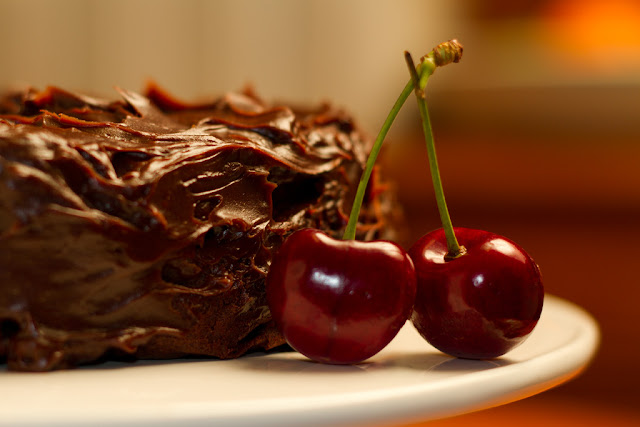 A photograph of a Cherry and Kirsch cake