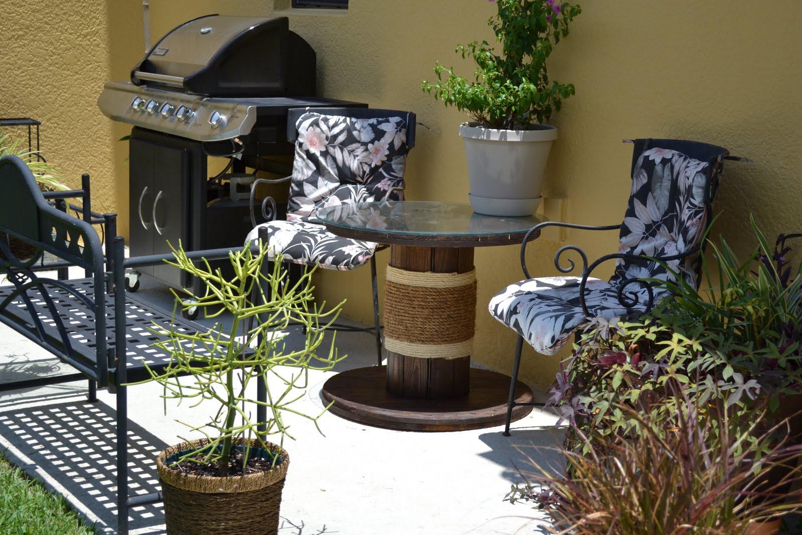 camelot art creations ballard designs inspired patio table no plant in the far corner