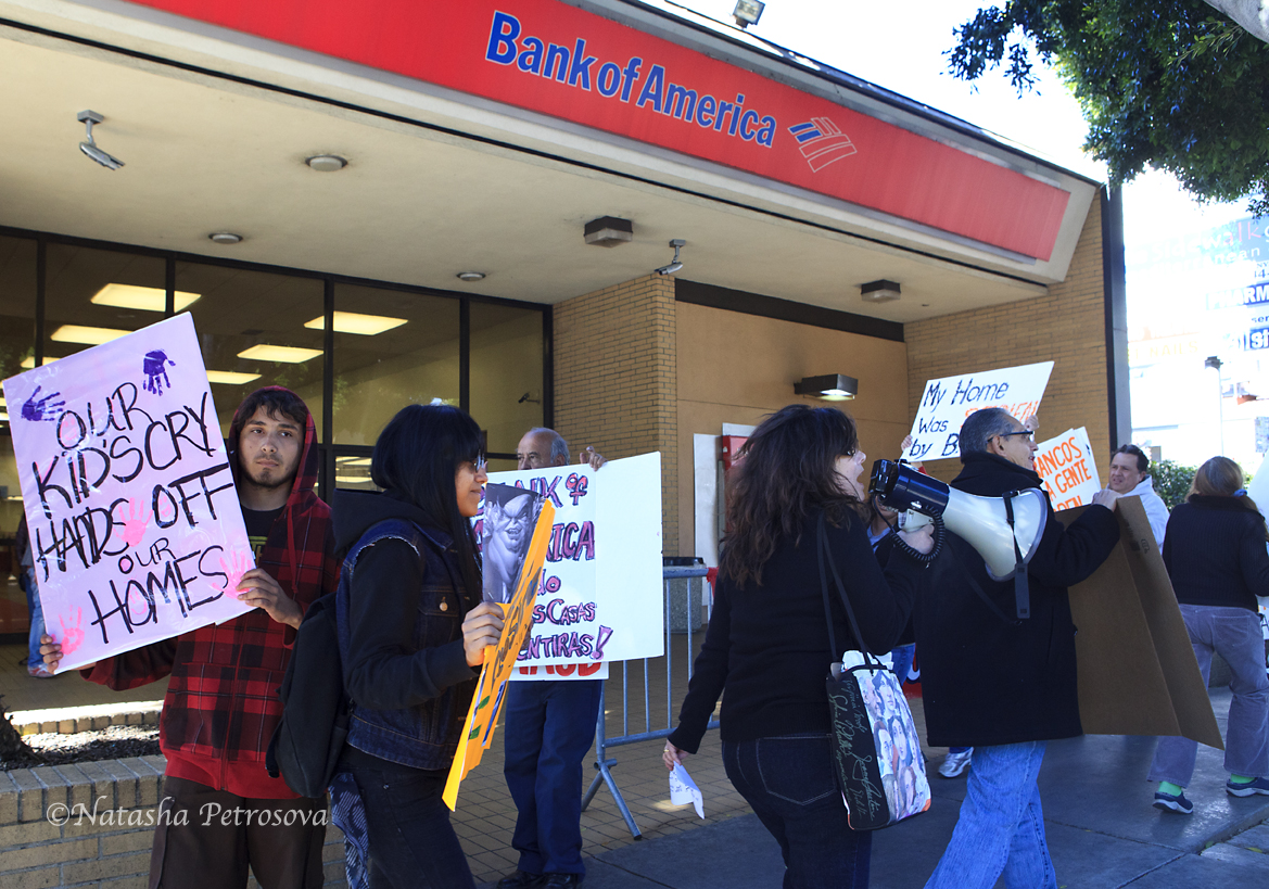 Protesters march in circle in front of Bank of America branch on North Vermont Street in Los Angeles, CA.