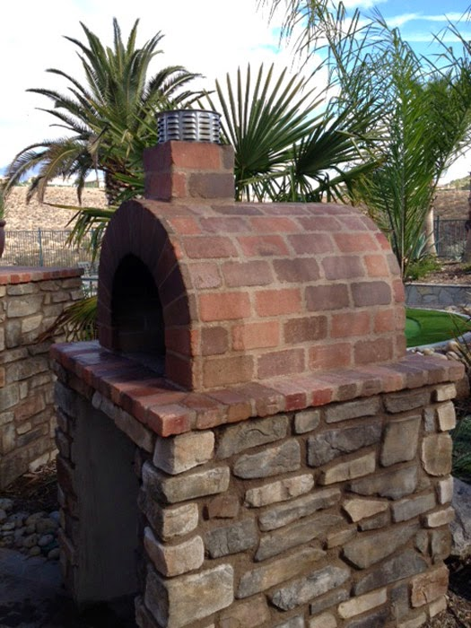 a beautiful wood fired brick pizza oven u0026 fireplace combination in sunny ca the oven was built using the mattone barile diy pizza oven foam form
