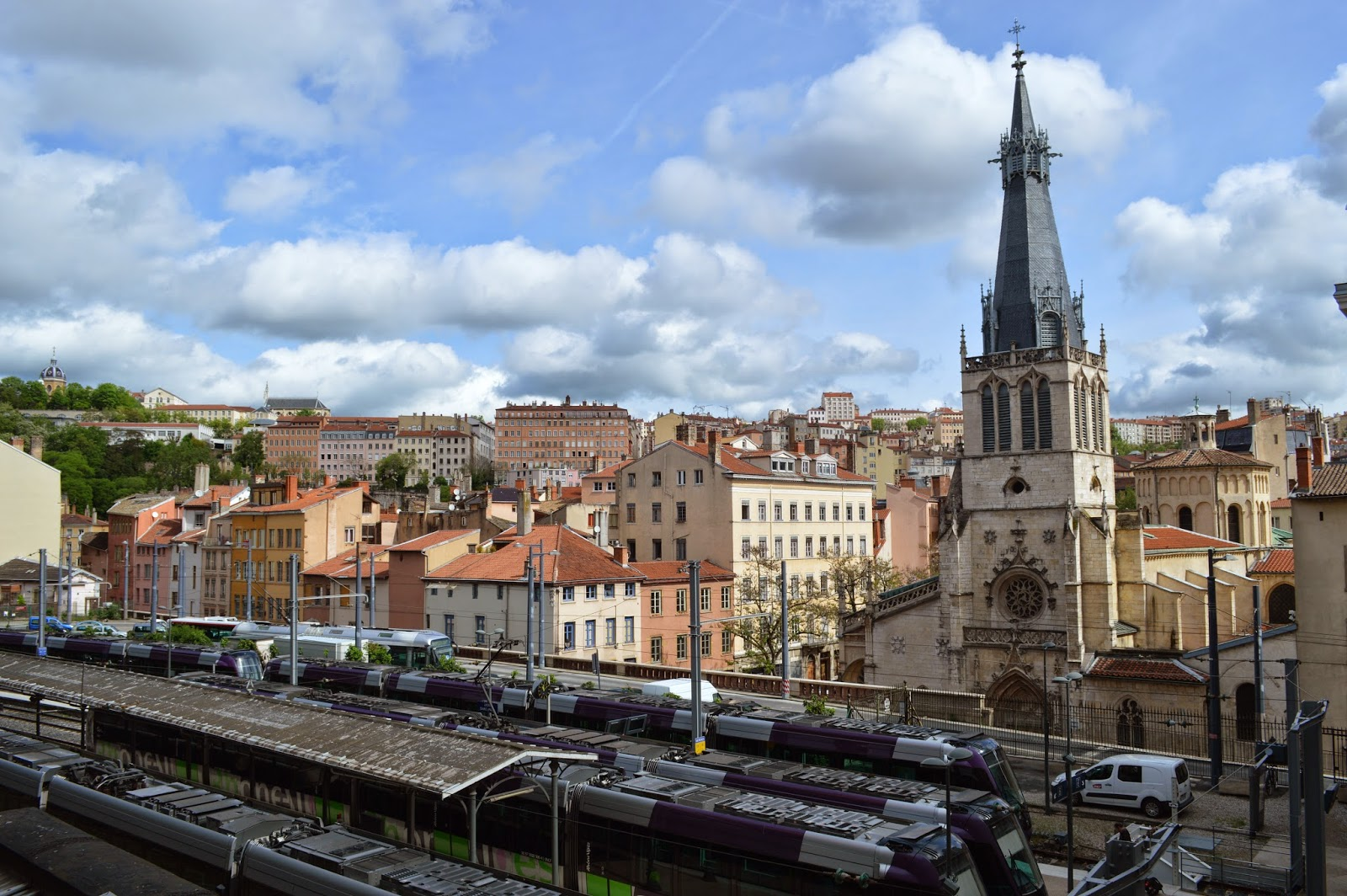 Train station with city behind Lyon
