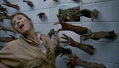 Zombie arms tear through the wall in Day of the Dead