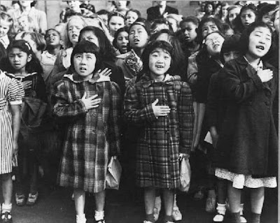 """Students at the Weill Public School reciting the Pledge of Allegiance, 1942.″ Photographer: Dorothea Lange. Library of Congress."