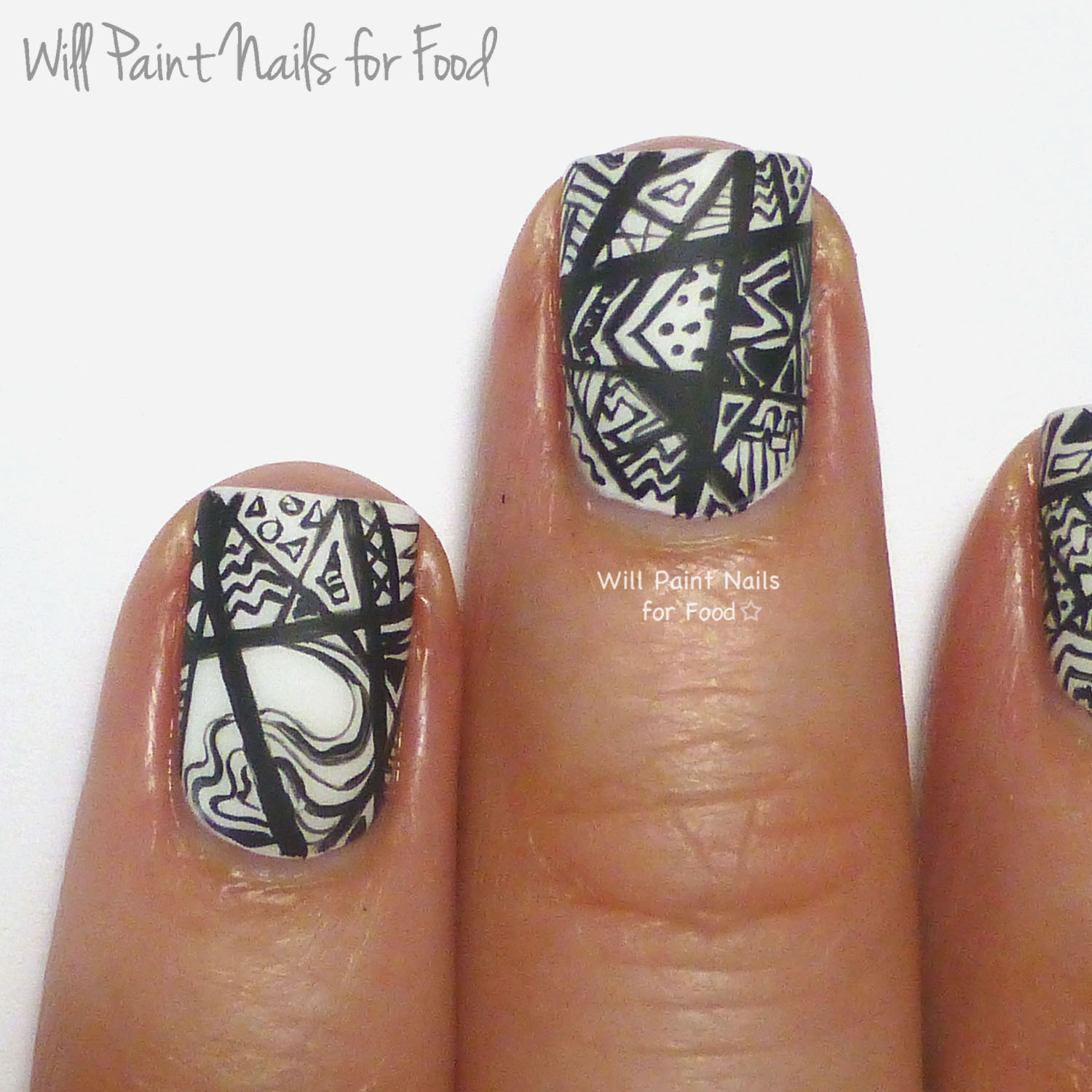 Black and white intricate abstract nail art (detail)