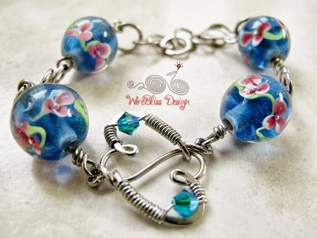 Blue Wire wrapped glass beads bracelet by Wirebliss
