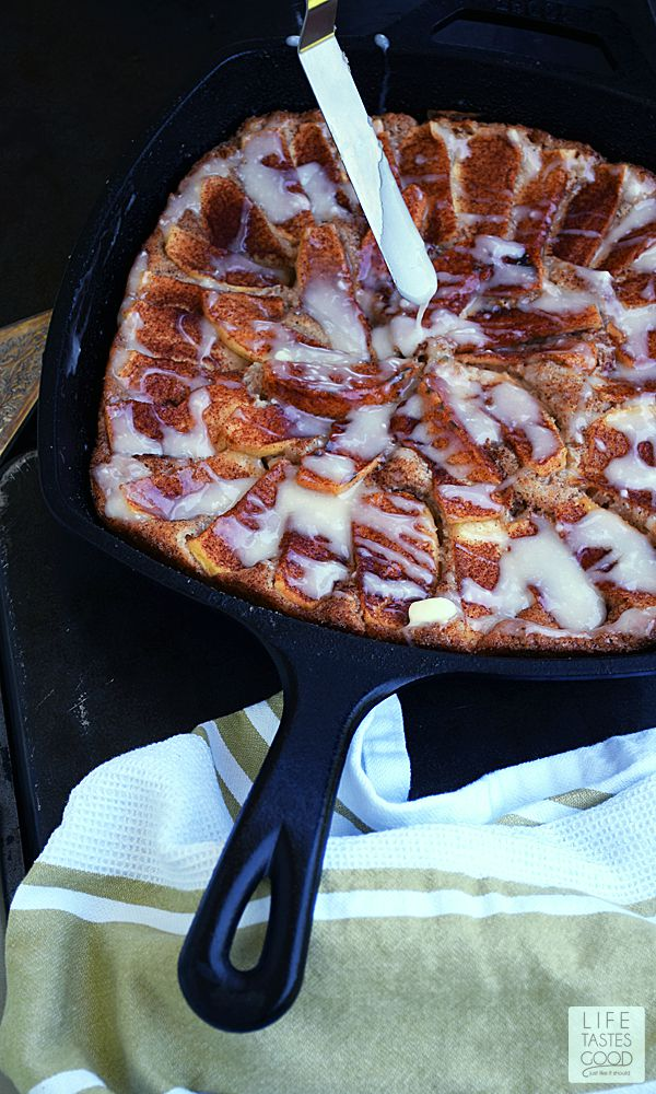 Skillet Apple Cake drizzled with a sweet, creamy glaze | by Life Tastes Good makes a fresh and irresistibly delicious dessert or even breakfast. Why not? There's fresh apples in this cake. Fruit for breakfast is perfectly acceptable, right?! #LTGRecipes