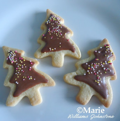Tree shaped cookies with chocolate and sprinkles