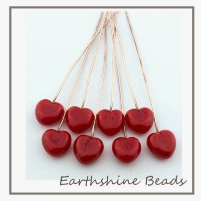 https://www.etsy.com/uk/listing/174196370/pair-of-handmade-lampwork-glass-red?ref=shop_home_active_14