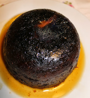 a traditional Christmas pudding with brandy