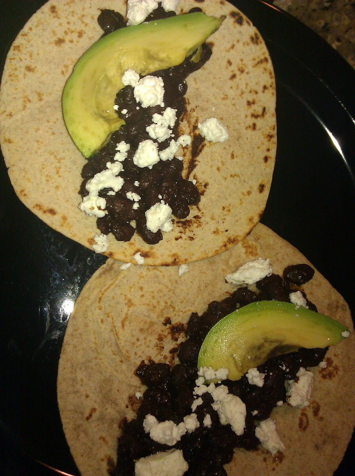 ... the center of a heated tortilla, layer avocado and goat cheese on top