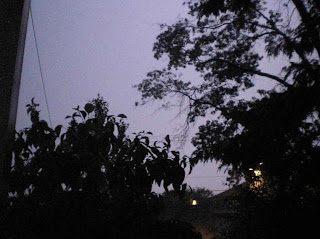 Anatomy of a lightning strike frame 2: The sky starts to turn purple as a pre-flash builds