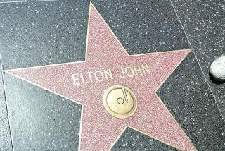 Elton John's a singer!