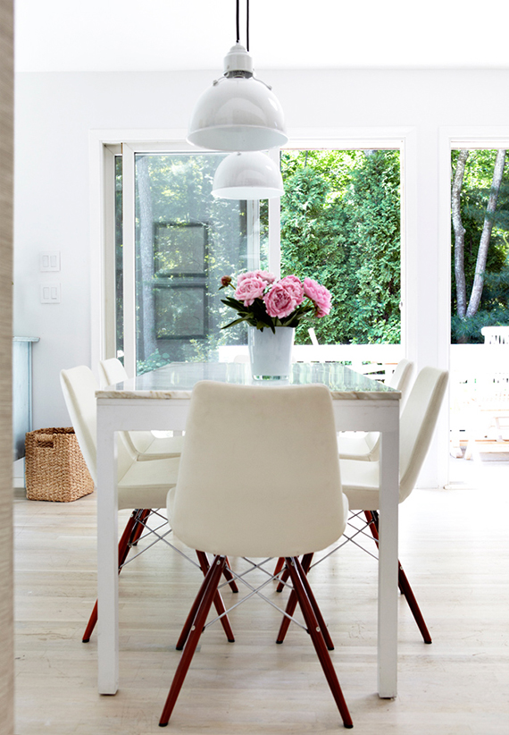 Marble top table in a charming dining room with large windows to the green outdoors. Image by Angelina Jolin via Skona Hem