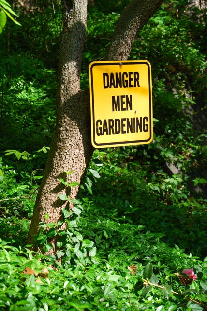 "A humorous garden sign: ""Danger: Men Gardening"" was one of the first views I noticed near the driveway."