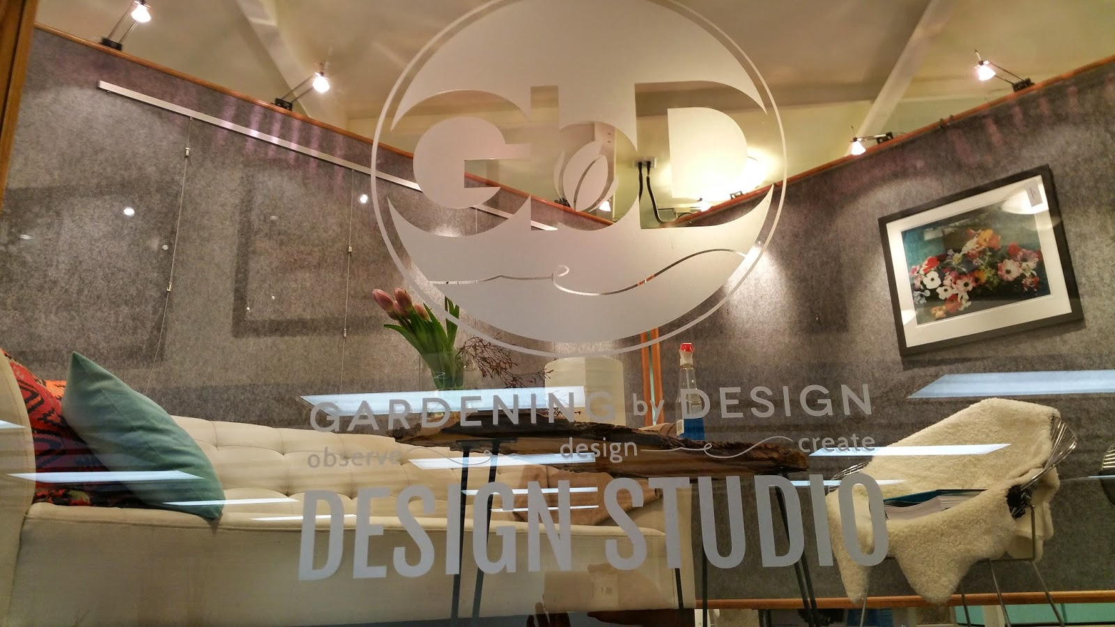 Etched Glass Decal on Mezzanine Glass Railing at Gardening by Design