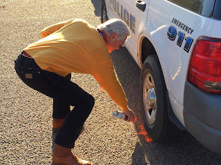 Resident marks location at a fake accident scene.