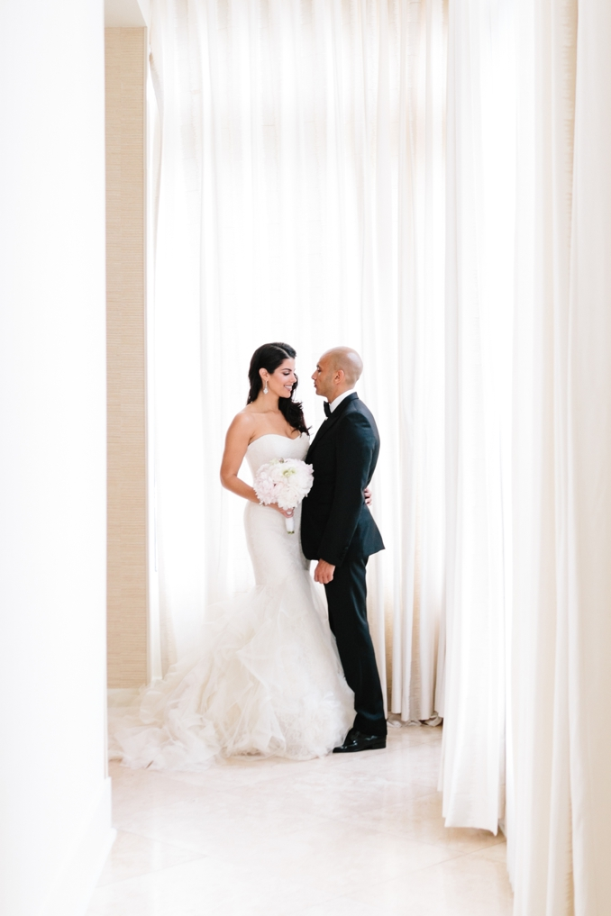 gorgeous portrait of the bride and groom in the penthouse at the raleigh hotel