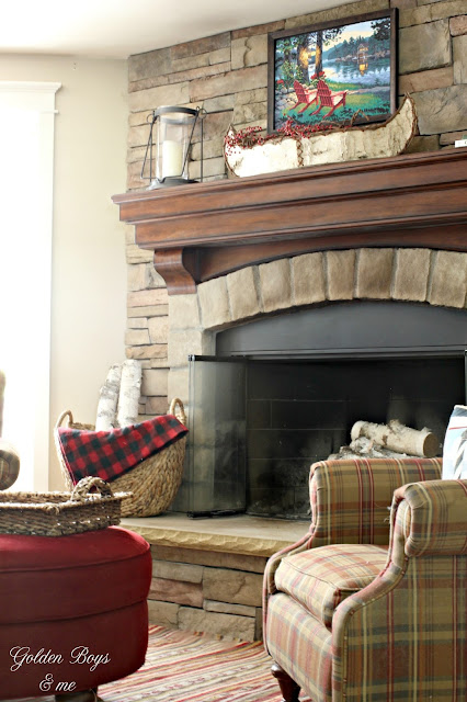 Corner stone fireplace with Bassett plaid chair and Ikea rug-www.goldenboysandme.com