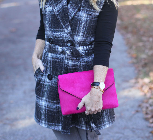 pink clutch, daniel wellington watch, vita fede bracelet