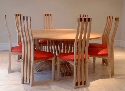 http://www.leesinclair.co.uk/Ash-and-Iroko-sculptural-dining-set.html