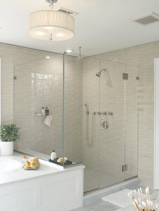 in this bathroom layout there was ample room for both a large tub left as well as a walk in ample shower lighting