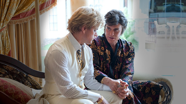 Michael Douglas holding Matt Damon's hand in Behind the Candelabra