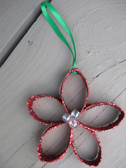 Craft klatch christmas flower ornament recycling craft for Recycle toilet paper rolls crafts