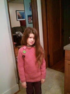 Amelia in her  Pickles sweater