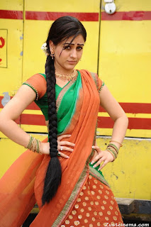 Aksha  Stills in Spicy Green Choli Backless Beauty half Saree