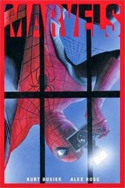 Cover of Marvels, featuring Spider-Man dangling upside down as he takes a photograph through a window.