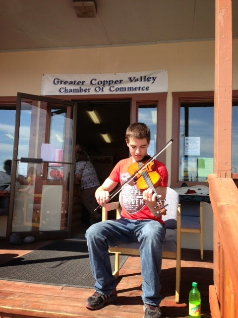 Fiddle playing at Copper Valley community event.